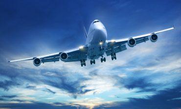 Airplane flying over blue skies