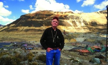 David Lowell posing in front of mountain