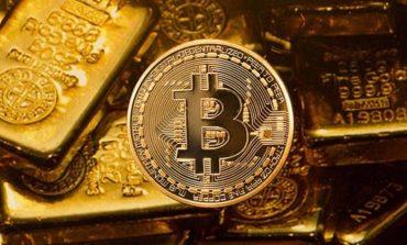 Bitcoin on top of gold bullion
