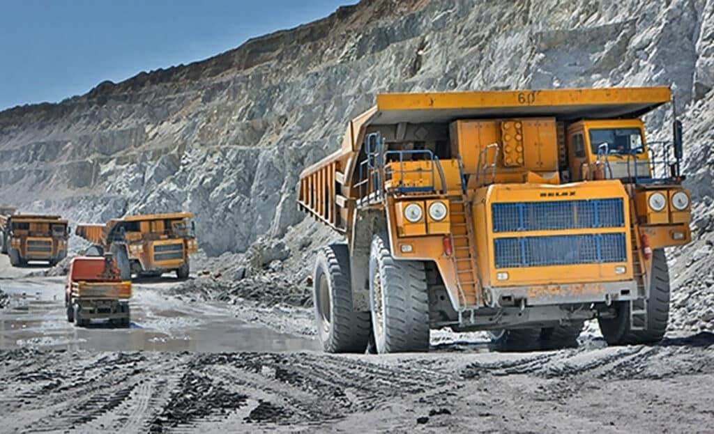 Big trucks in mining pit