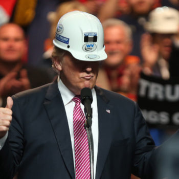 Trump wearing hard hat giving thumbs up