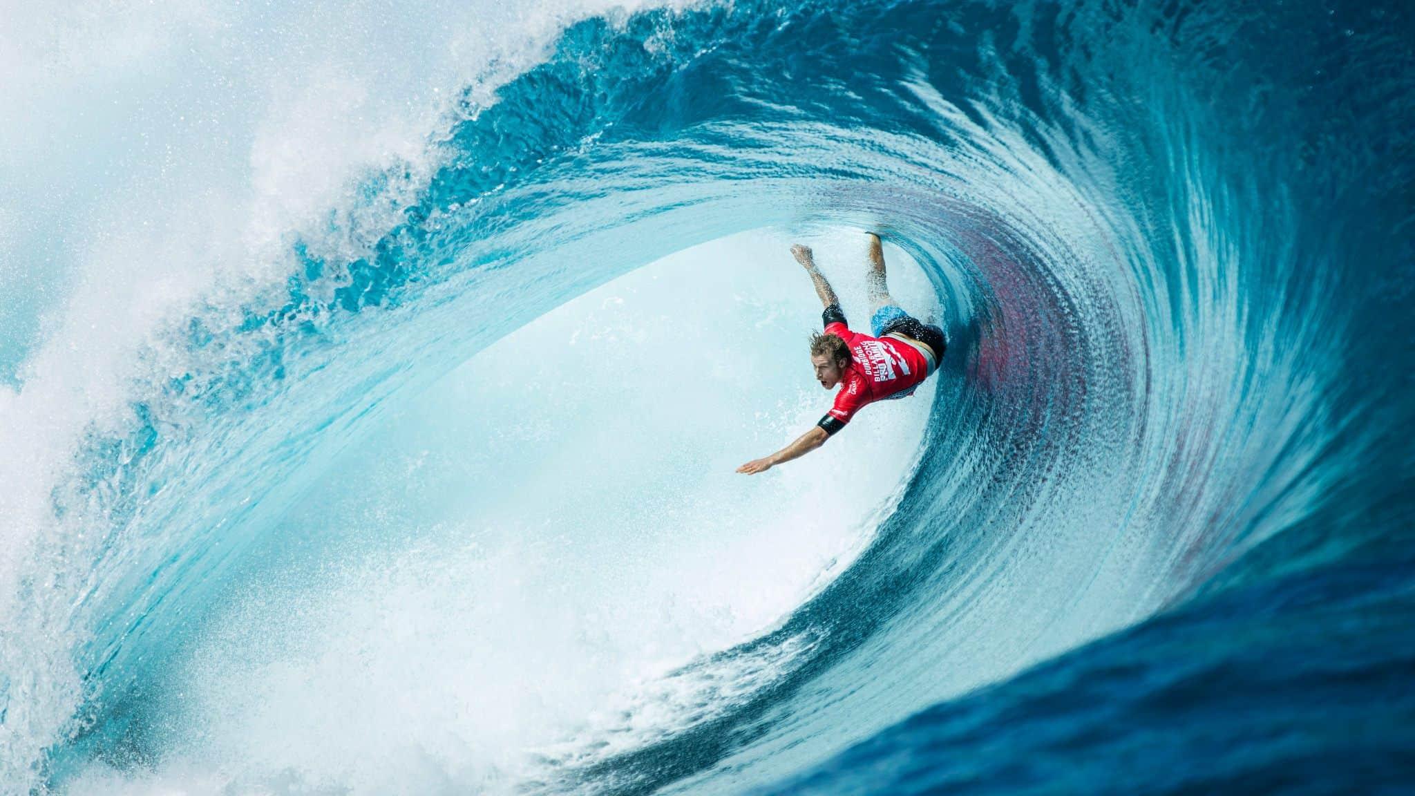 Man surfing huge wave