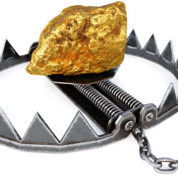 Trap with gold nugget on white background.